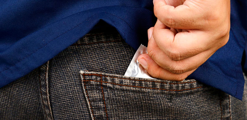 Image of condom in pocket. Photo Credit: Copyright: leolintang / 123RF Stock Photo